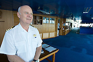 Captain Nicholas Bates aboard his bridge.  Bates is in a class by himself among the elite group of ship's captains.  Pacific cruise aboard the Sapphire Princess from Pacific Cruise Lines.