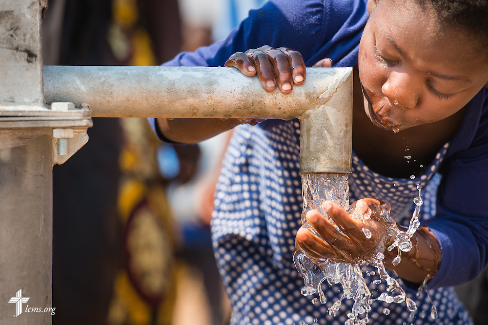 A child drinks from a new LCMS funded well on Saturday, Sept. 26, in Embangweni, Malawi. LCMS Communications/Erik M. Lunsford