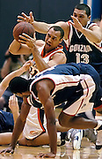 2.20.06--Malibu California--Pepperdine #11 Keith Jarbo scraps for a loose ball with Gonzaga #4 Pierre Marie Altidor-Cespedes and #13 J.P. Batista. Pepperdine fell to Gonzaga by a score of 71-81. photo by John McCoy/Staff Photographer Los Angeles Daily News