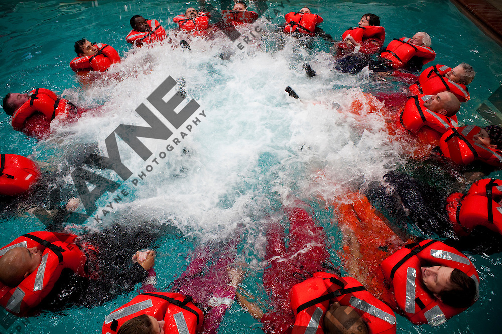 Feb. 15, 2010 - Participants form a survival circle to improve visibility in open water by aircraft during a class in open water survival techniques, taught by Garrett Hindt, center Feb. 15, 2010 in Brookshire, TX. All workers, contractors and visitors are now required to do the training, which also incorporates a simulated helicopter crash (in a swimming pool) and emergency steps used to free oneself while underwater.