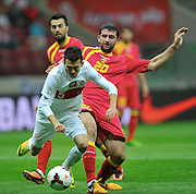 Montenegro's Miodrag Dzudovic and Waldemar Sobota of Poland during the FIFA World Cup 2014 group H qualifying football match of Poland vs Montenegro on September 6, 2013 in Warsaw, <br />Photo by: Piotr Hawalej