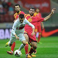 Montenegro's Miodrag Dzudovic and Waldemar Sobota of Poland during the FIFA World Cup 2014 group H qualifying football match of Poland vs Montenegro on September 6, 2013 in Warsaw, <br />