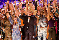 Elton John and the cast of Hair perform at the 2009 Tony Awards at Radio City Music Hall.