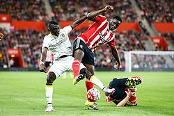 Victor Wanyama of Southampton is tackled by Valeri Kazaishvili of Vitesse Arnhem  - Mandatory by-line: Jason Brown/JMP - Mobile 07966386802 - 31/07/2015 - SPORT - FOOTBALL - Southampton, St Mary's Stadium - Southampton v Vitesse Arnhem - Europa League