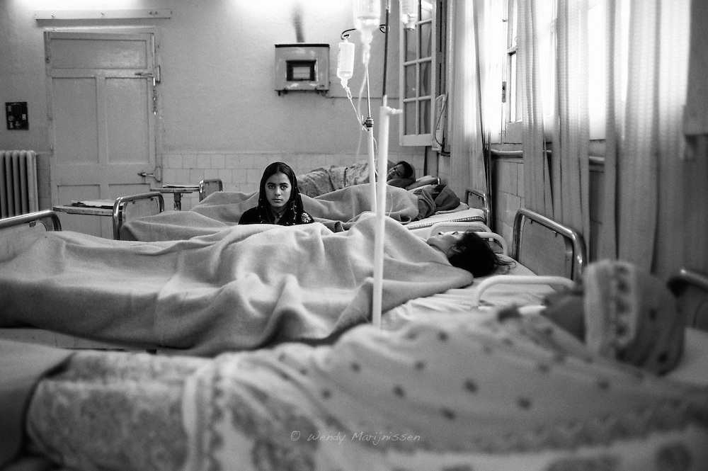 A girl is sitting by the bed of her mother, who is waiting to undergo a fistula repair operation in the Free Fistula Clinic of the Lady Willingdon clinic in Lahore. .Obstetric fistula is a hole in the birth canal caused by prolonged labour without prompt medical intervention, usually a Caesarean section. The woman is left with chronic incontinence and, in most cases, a stillborn baby. Every year 4000 to 5000 new cases of fistula occur in Pakistan.