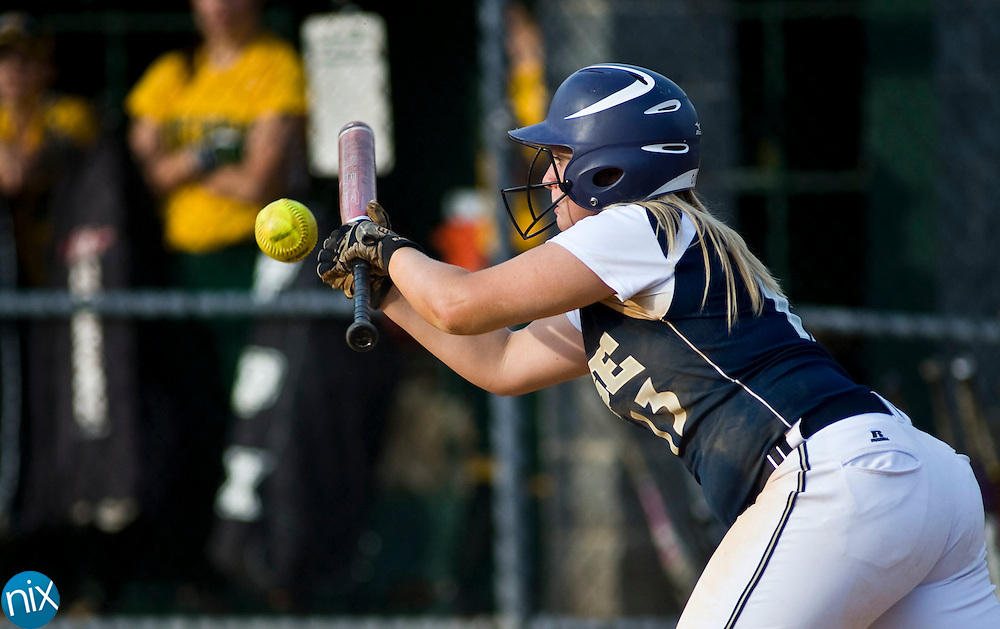 Hickory Ridge's Julia Sanders bunts against Central Cabarrus Tuesday evening at Central Cabarrus High School. Hickory Ridge won the game 7-1.  (Photo by James Nix)