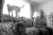 Fabiola Trejo sits alone in her Newark, Calif. home. Her husband Robert was diagnosed with Alzheimer's disease in 2002, and Fabiola cares for her husband of over 60 years alone.