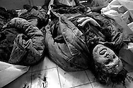 The bodies of dead Bosnian soldiers just collected from the frontline lie in the morgue at Kosevo Hospital, Sarajevo, Bosnia-Herzegovina, February 1993. PHOTO BY ROGER RICHARDS
