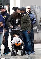 """EXCLUSIF - Eros Ramazzotti, sa compagne Marica Pellegrinelli et leur fille Raffaella Maria de passage à Bruxelles en Belgique, pour deux concerts.<br /> Le couple qui se mariera très prochainement mais l'endroit du mariage reste à ce jour tenu secret.<br /> Sa compagne Marica Pellegrinelli qui d'après le magazine italien """" OGGI """" aurait annoncé qu'elle serait enceinte de quelques semaines.<br /> Le couple s'est promené avec leur fille dans les rues de Bruxelles en toute sérénité, cependant Eros n'a pas quitté sa balle anti-stress, mais toute-fois, ceci ne l'a pas empêché d'affirmer sa passion pour l'équipe de la Juventus en brandissant son écharpe.<br /> Eros n'a pas hésité à saluer ses fans et à poser avec eux pour une séance photo et à même plaisanté avec les voituriers de l'hôtel en subtilisant le chapeau haut-de-forme de l'un d'eux."""