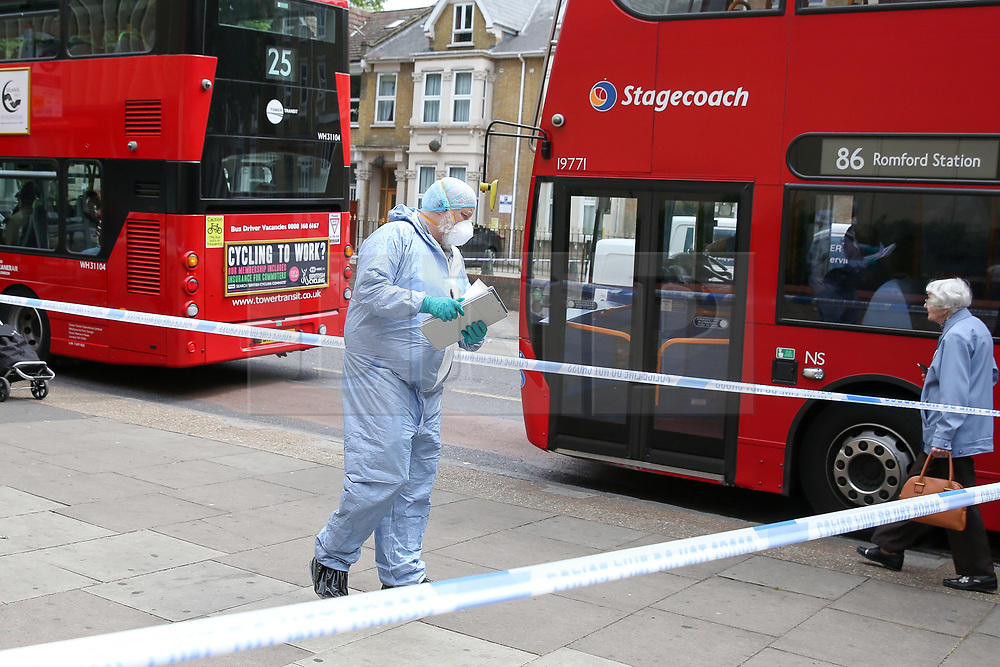 © Licensed to London News Pictures. 28/05/2019. London, UK. A forensic officer on Romford Road, Forest Gate, East London where a man in his 30s died in the early hours of this morning following a flight on Warwick Road.<br />