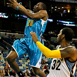 October 9, 2010; New Orleans, LA, USA; New Orleans Hornets small forward Quincy Pondexter (20) shoots over Memphis Grizzlies shooting guard O.J. Mayo (32) during the second half of a preseason game at the New Orleans Arena.The Grizzlies defeated the Hornets 97-90. Mandatory Credit: Derick E. Hingle
