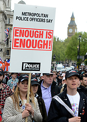 © Licensed to London News Pictures. 10/05/2012. Westminster, UK Off duty police officers take part in a Police Federation protest over proposed changes to pay and conditions. Tony Melville, the outgoing chief constable of Gloucestershire Police, was among the marchers. Photo credit : Stephen Simpson/LNP