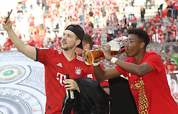18.05.2019, Allianz Arena, Muenchen, GER, 1. FBL, FC Bayern Muenchen vs Eintracht Frankfurt, 34. Runde, Meisterfeier nach Spielende, im Bild David Alaba mit Fan // during the celebration after winning the championship of German Bundesliga season 2018/2019. Allianz Arena in Munich, Germany on 2019/05/18. EXPA Pictures © 2019, PhotoCredit: EXPA/ SM<br /> <br /> *****ATTENTION - OUT of GER*****