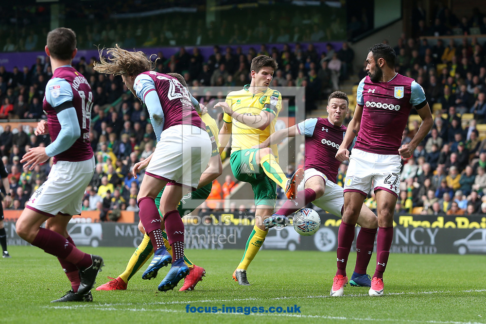 Timm Klose of Norwich has a shot on goal during the Sky Bet Championship match at Carrow Road, Norwich<br /> Picture by Paul Chesterton/Focus Images Ltd +44 7904 640267<br /> 07/04/2018