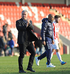 Cheltenham Town Manager, Russell Milton applauds fans after the final whistle. Photo mandatory by-line: Nizaam Jones - Mobile: 07966 386802 - 21/03/2015 - SPORT - Football - Cheltenham - Whaddon Road - Cheltenham Town v Exeter City - Sky Bet League Two