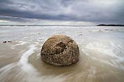 The Moeraki Boulders are a collection of large, semi-spherical boulders on Koekohe Beach near Moeraki on the Otago Coast, New Zealand.