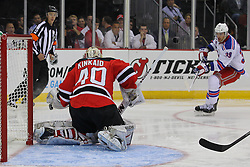 Sep 16, 2013; Newark, NJ, USA; New Jersey Devils goalie Keith Kinkaid (40) makes a save on New York Rangers left wing Marek Hrivik (39) during the third period at Prudential Center. The Devils defeated the Rangers 2-1.
