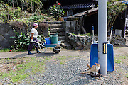Aoshima, Ehime prefecture, September 4 2015 - Local residents and sone of the numerous cats of Aoshima island,<br /> Aoshima (Ao island) is one of the several « cat islands » in Japan. Due to the decreasing of its poluation, the island now host about 6 times more cats than residents.