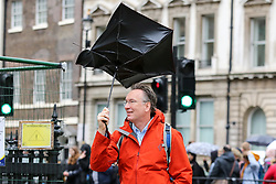 © Licensed to London News Pictures. 16/10/2019. London, UK. A man struggles to control her umbrella in Westminster, London. According to the Met Office more rain is forecasted for the next few days. Photo credit: Dinendra Haria/LNP
