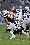 Los Angeles Chargers defensive end Joey Bosa (99) rushes during the 2017 NFL week 1 preseason football game against the Seattle Seahawks, Sunday, Aug. 13, 2017 in Carson, Calif. The Seahawks won the game 48-17. (©Paul Anthony Spinelli)