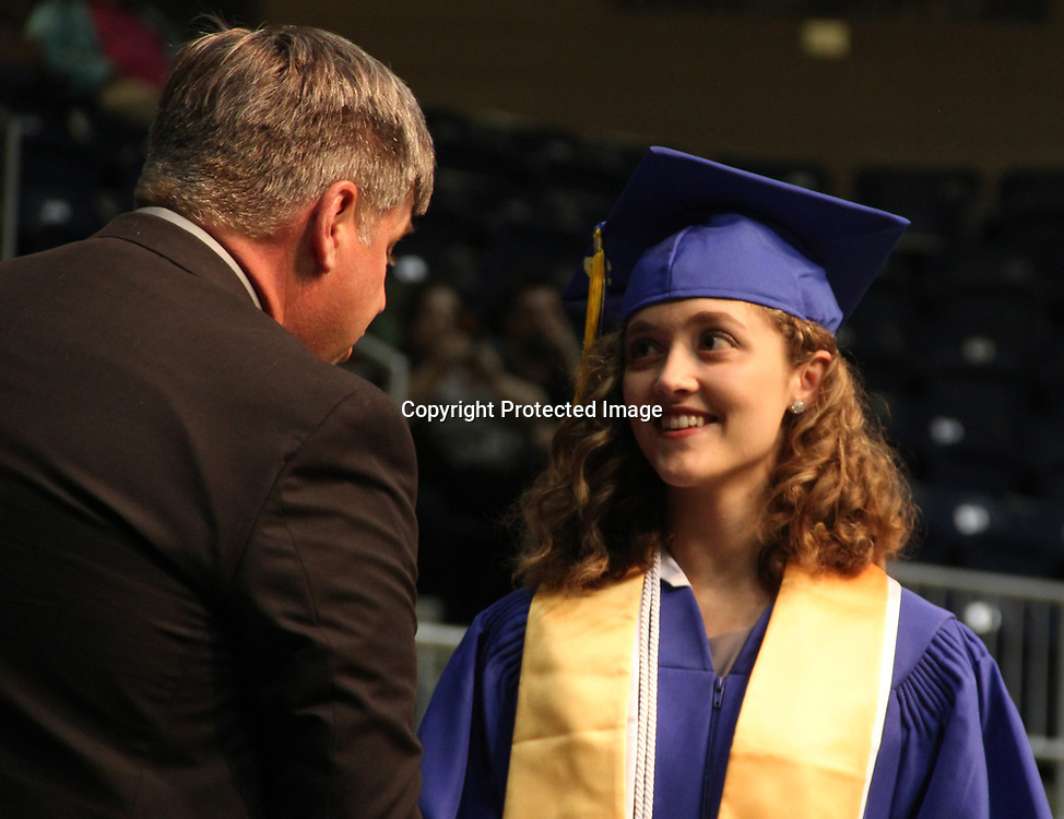 Superintendent of Education Michael Nanney shakes hands with Tremont graduates.