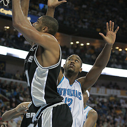 17 December 2008:  San Antonio Spurs forward Tim Duncan (21) shoots as New Orleans Hornets center Hilton Armstrong (12) defends during a 90-83 victory by the New Orleans Hornets over the San Antonio Spurs at the New Orleans Arena in New Orleans, LA..