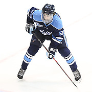 Blaine Byron #89 of the Maine Black Bears on the ice during the game at Matthews Arena on February 22, 2014 in Boston, Massachusetts. (Photo by Elan Kawesch)