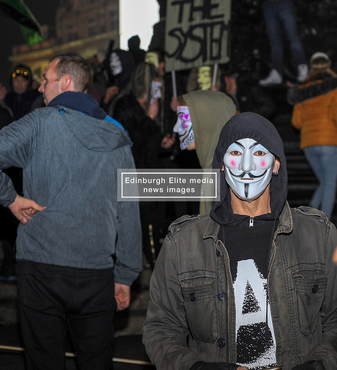 A protester poses for photos during the annual 'Million Mask March' demonstration. London, 05 November 2018.