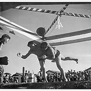 Two of the residents at this relocation center who participated in the wrestling tournament Thanksgiving day. -- Photographer: Stewart, Francis -- Rivers, Arizona. 11/26/42<br /> Identifier:<br /> Volume 5<br /> Identifier:<br /> Section A<br /> Identifier:<br /> WRA no. D-668<br /> Collection:<br /> War Relocation Authority Photographs of Japanese-American Evacuation and Resettlement Series 2: Gila River Relocation Center (Rivers, AZ)<br /> Contributing Institution:<br /> The Bancroft Library. University of California, Berkeley.