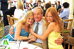 Left to right, ALEXIA INGE, NEIL HAMILTON and OLIVIA INGE at a charity polo match organised by Jaeger Le Coultre was held at Ham Polo Club, Richmond, Surrey on 12th June 2009.