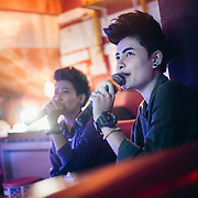 Pattaya, April 10, 2017 - Oscar Club, The best and most popular place to meet Toms in Pattaya located off Soi Buakhao. When I first entered this place one of the many hot (and handsome) Tomboys giggled while asking me: &ldquo;Are you a Adam?&rdquo; That&rsquo;s how they call guys who like Toms here in Thailand. This place is mainly a karaoke but they also have a big main room where it feels more like a bar &ndash; or pub how the Thais like to say.<br /> Thailand's 'tom' (as in tomboys) inhabit a unique place on the gender spectrum. They are girls who dress and act in a masculine way, typically sporting a uniform look of short hair, t-shirts and jeans. But toms don't consider themselves trans or even lesbians, despite the fact that they date women (often girly 'dees' or other toms). <br /> <br /> You can&rsquo;t choose how you&rsquo;re born, but you can choose how to live your life. Thailand seems to be the most tolerant place for the LGBTI (lesbian, gay, bisexual, transgender, intersex ) community. However, tolerance doesn&rsquo;t mean acceptance. For the LGBTI people who have already revealed their gender identity tend to often be the ones that have been mistreated by the general public and the media due to the lack of knowledge and understanding. In Thai society, transmen are still in the shadow of &lsquo;tomboy&rsquo; culture. While the terms of &lsquo;transwoman&rsquo; and &lsquo;tomboy&rsquo; have been well known among Thai people for many decades, the term of &lsquo;transman&rsquo; only been introduced about 5 years ago. &ldquo;Phu Chai Kham Phej&rdquo; is a Thai term that has been translated from a western term &lsquo;transman&rsquo; which means a transgender person who was assigned female at birth but whose gender identity is that of a man. &copy; Jean-Michel Clajot