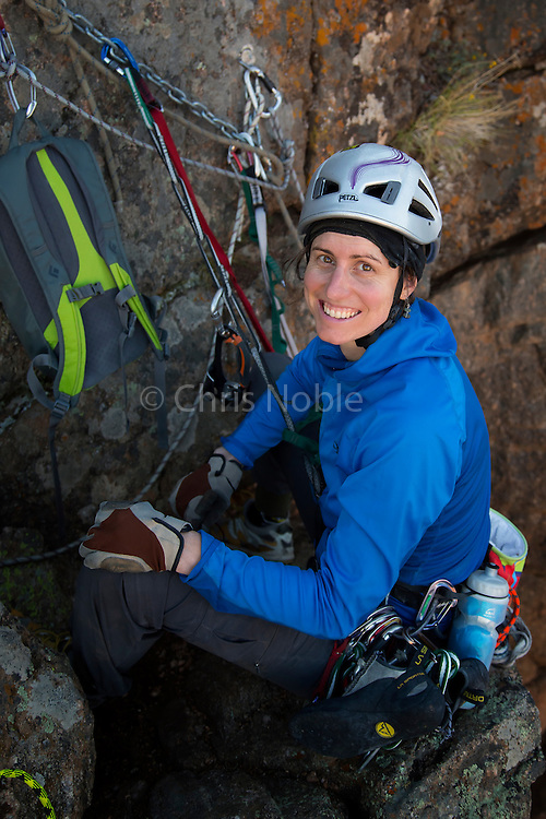 "Portait of big wall climber Madaleine Sorkin at the final belay after topping out on ""Tague Yer Time,"" 12b, South Rim, Black Canyon of the Gunnison."