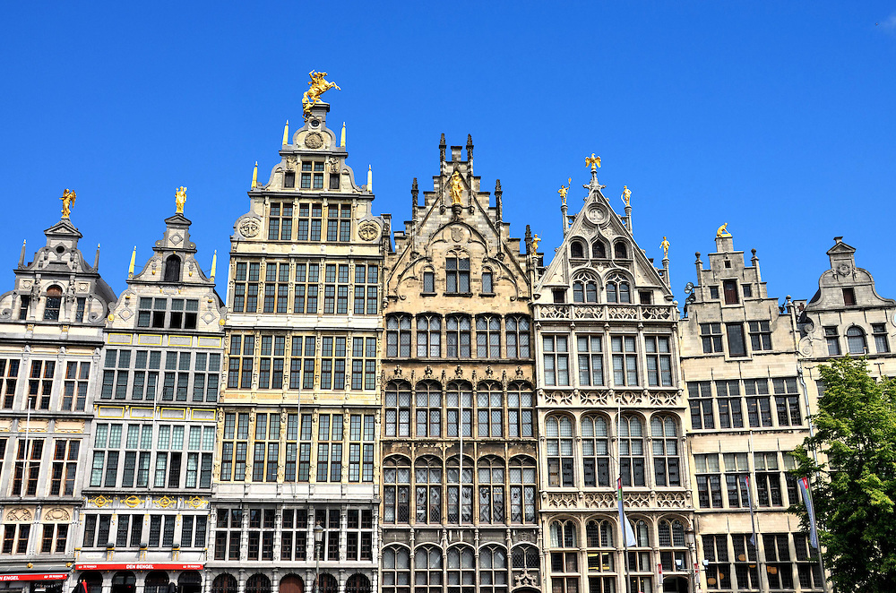 Guild Houses in Grote Markt in Antwerp, Belgium <br /> Surrounding Grote Markt, a square in the center of Antwerp, is a row of guild houses that were originally built around 1580.  During the Middle Ages, merchant trades in the Low Countries of Belgium and the Netherlands strove to create their own unique and impressive hall to reflect their success.  Typically, the ornate facades had their coat of arms and a gilded statue on top.  The originals were significantly damaged in a 1576 fire while others were destroyed during WWII, but they were faithfully reconstructed in the 19th and early 20th centuries.