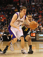 Feb. 15, 2011; Phoenix, AZ, USA; Phoenix Suns guard Goran Dragic (2) is guarded by the Utah Jazz guard Earl Watson (11) at the US Airways Center. Mandatory Credit: Jennifer Stewart-US PRESSWIRE