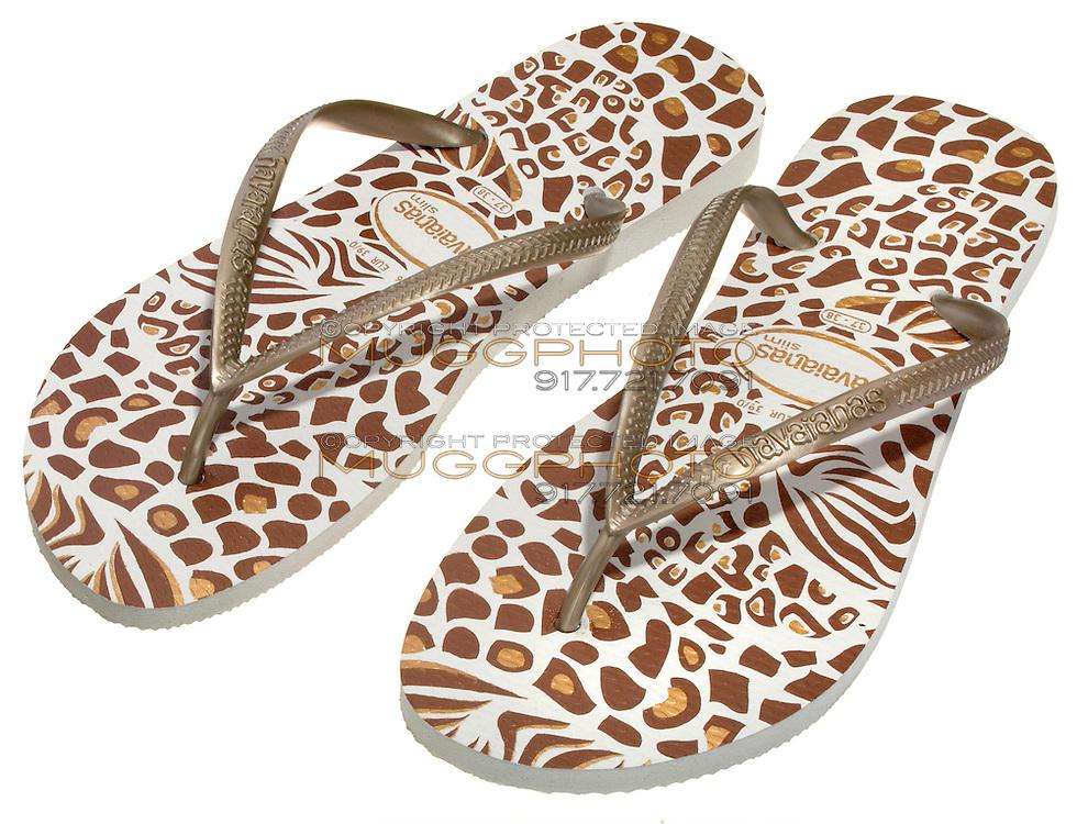 brown and gold animal print havaianas flip flops