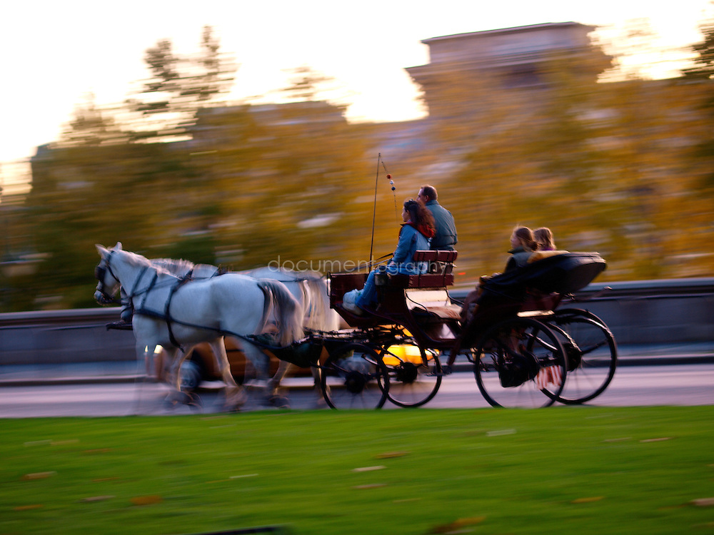 Tourists touring the city of Budapest on a horse carriage, Budapest, Hungary.
