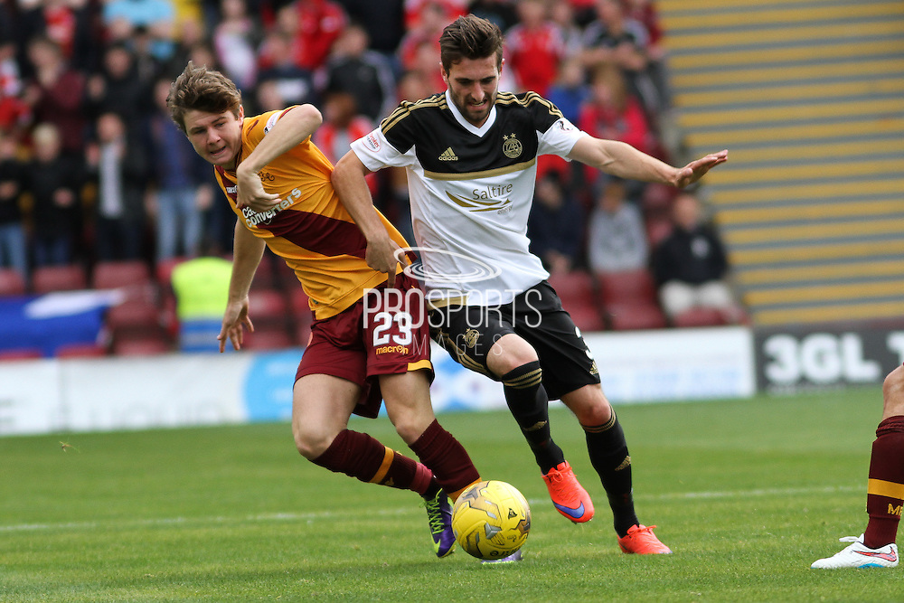 Graeme Shinnie shoulders passed Dom Thomas during the Ladbrokes Scottish Premiership match between Motherwell and Aberdeen at Fir Park, Motherwell, Scotland on 15 August 2015. Photo by Craig McAllister.