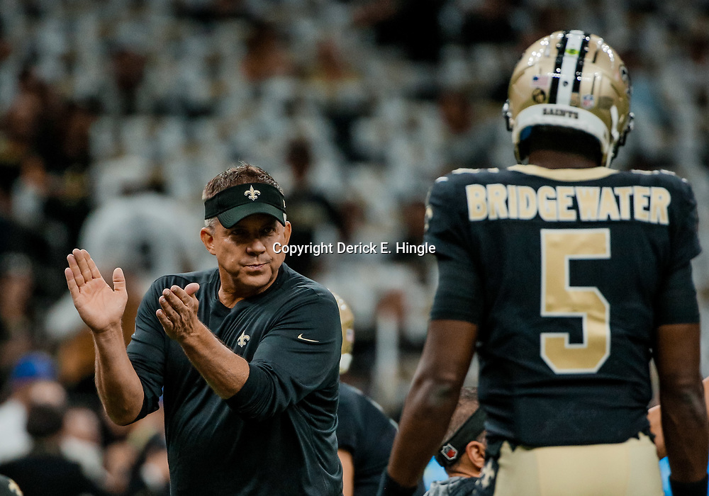 Sep 9, 2018; New Orleans, LA, USA; New Orleans Saints head coach Sean Payton looks over to quarterback Teddy Bridgewater (5) before a game against the Tampa Bay Buccaneers at the Mercedes-Benz Superdome. Mandatory Credit: Derick E. Hingle-USA TODAY Sports