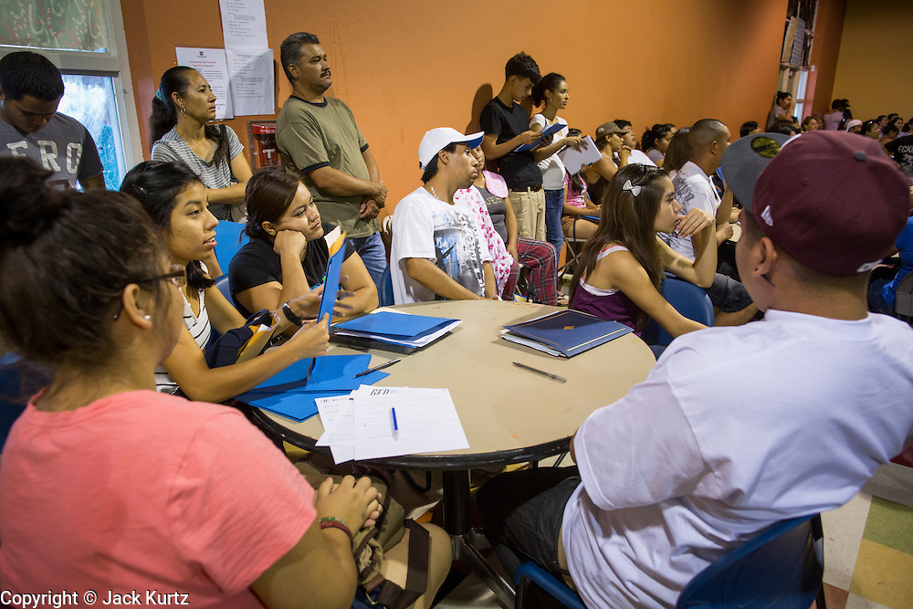"18 AUGUST 2012 - PHOENIX, AZ: People at a deferred action workshop in Phoenix. More than 1000 people attended a series of 90 minute workshops in Phoenix Saturday on the ""deferred action"" announced by President Obama in June. Under the plan, young people brought to the US without papers, would under certain circumstances, not be subject to deportation. The plan mirrors some aspects the DREAM Act (acronym for Development, Relief, and Education for Alien Minors), that immigration advocates have sought for years. The workshops were sponsored by No DREAM Deferred Coalition.  PHOTO BY JACK KURTZ"