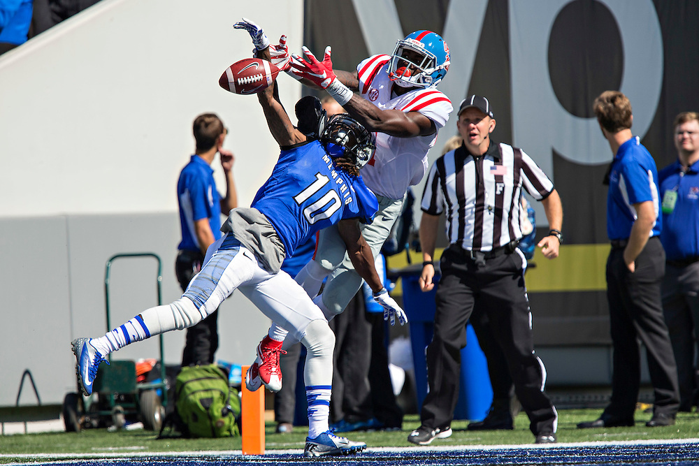MEMPHIS, TN - OCTOBER 17:  Clay Holgorsen #10 of the Memphis Tigers breaks up a pass thrown to Laquon Treadwell #1 of the Ole Miss Rebels at Liberty Bowl Memorial Stadium on October 17, 2015 in Memphis, Tennessee.  The Tigers defeated the Rebels 37-24.  (Photo by Wesley Hitt/Getty Images) *** Local Caption ***  Clay Holgorsen; Laquon Treadwell