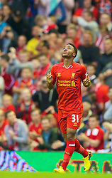 27.08.2013, Anfield, Liverpool, ENG, League Cup, FC Liverpool vs Notts County FC, 2. Runde, im Bild Liverpool's Raheem Sterling celebrates scoring the first goal against Notts County during the English League Cup 2nd round match between Liverpool FC and Notts County FC, at Anfield, Liverpool, Great Britain on 2013/08/27. EXPA Pictures © 2013, PhotoCredit: EXPA/ Propagandaphoto/ David Rawcliffe<br /> <br /> ***** ATTENTION - OUT OF ENG, GBR, UK *****