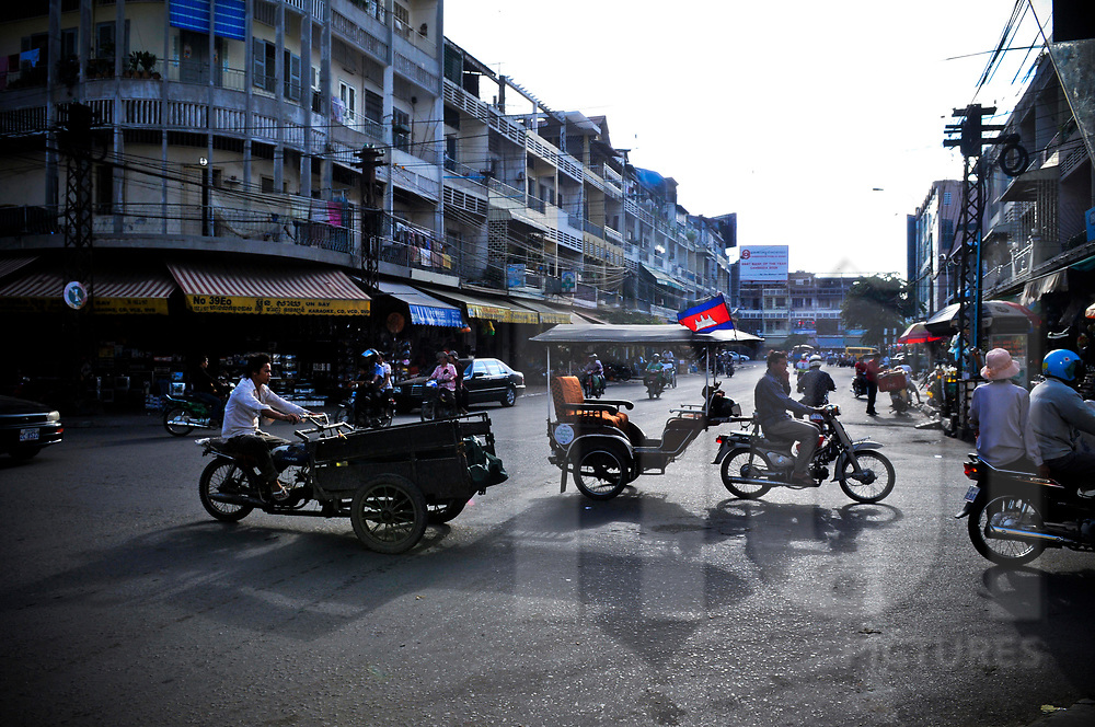 Busy crossroad in a street of Phnom Penh, Cambodia, Southeast Asia