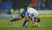 Photo: Aidan Ellis.<br /> Bolton Wanderers v Zenit St Petersburg. UEFA Cup. <br /> 03/11/2005.<br /> Bolton's Jay-Jay Okocha battles with Zenit's Egor Denisov