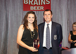 CARDIFF, WALES - Tuesday, October 4, 2011: Wales' Nia Jones is presented with the Young Player of the Year Award by manager Jarmo Matikainen at the FAW Footballer of the Year Awards 2011 held at the Wales National Museum. (Pic by David Rawcliffe/Propaganda)