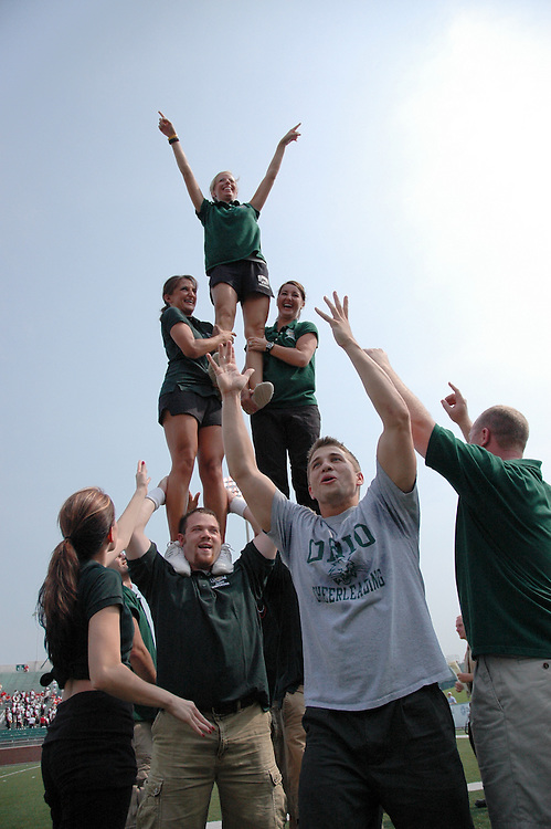 Top to bottom- Erin Ginley.        Lindsay Anast, Katie Gibson.Josh Stegman, and Daniel Schaff..Alumni Cheerleaders Group Pyramid