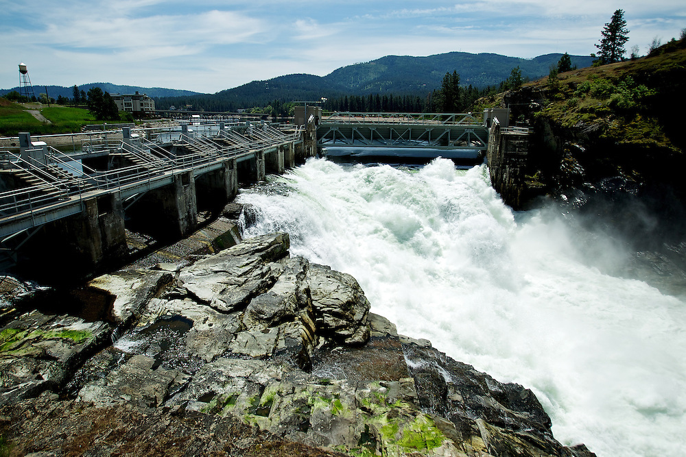 Water rushes through the remaining spillways opened at the Post Falls dam Tuesday as Avista has began to close the gates to maintain summer water levels.