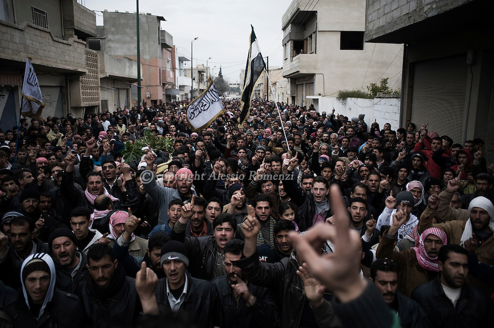 SYRIA - Al Qsair. Thousands attend the funeral of the the three men kidnapped and tortured by shabiha (militias of the regime) during three days. The bodies were found  in a main street of Al  Qsair, on February 14, 2012. ALESSIO ROMENZI