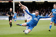 Wycombe midfielder Matthew Bloomfield (10) fouls Peterborough Utd defender Jason Naismith (2) during the EFL Sky Bet League 1 match between Peterborough United and Wycombe Wanderers at London Road, Peterborough, England on 2 March 2019.