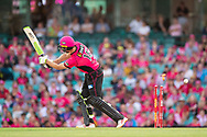 Sydney Sixers player Daniel Hughes misses the ball and gets bowled out at the Big Bash League cricket match between Sydney Sixers and Melbourne Stars at The Sydney Cricket Ground in Sydney, Australia