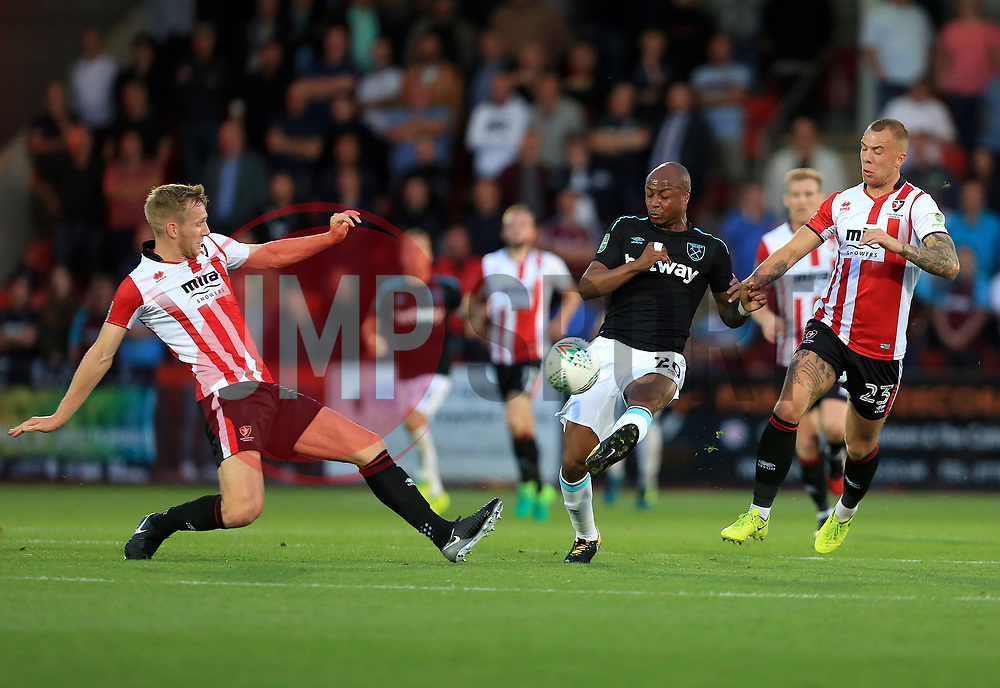 Jamie Grimes of Cheltenham Town blocks a Andre Ayew of West Ham United pass - Mandatory by-line: Paul Roberts/JMP - 23/08/2017 - FOOTBALL - LCI Rail Stadium - Cheltenham, England - Cheltenham Town v West Ham United - Carabao Cup